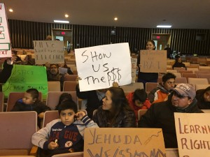 Jane Lerner/The Journal News Parents protest at a  school board meeting in East Ramapo. Parents protest at a recent school board meeting in East Ramapo.